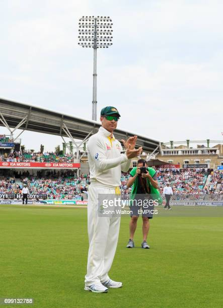 Australia's captain Michael Clarke waves to the crowd as he walks out