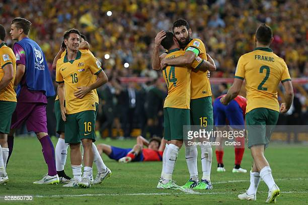 Australia's captain Mile Jedinak hugs James Troisi after the match against the Korea Republic at Stadium Australia Sydney Australia Saturday 31st...