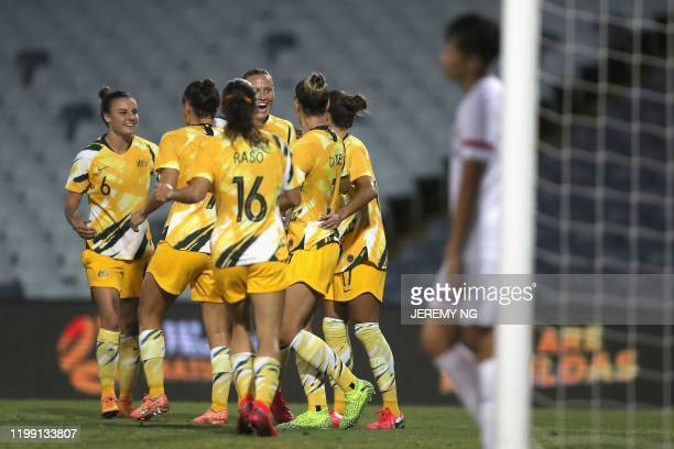 Australias captain Stephanie Catley celebrates her goal with her teammates during the women's Olympic football tournament qualifier match between...