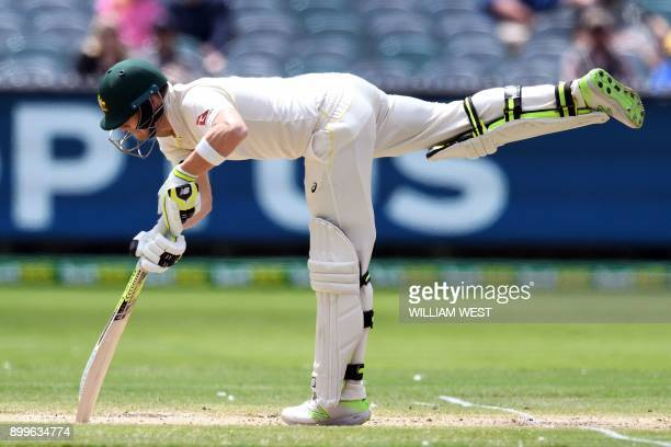 Australia's captain Steve Smith overbalances after a delivery from England on the final day of the fourth Ashes cricket Test match at the MCG in...