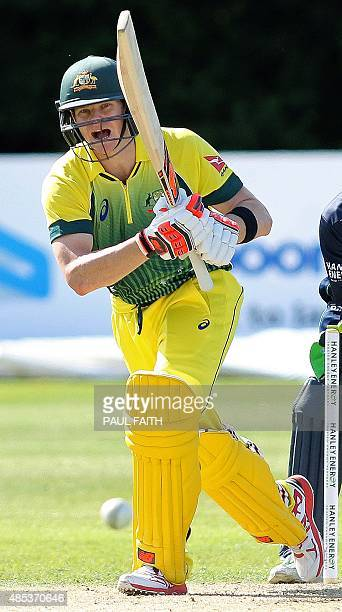 Australia's captain Steve Smith watches the ball after playing a shot during the one day international cricket match between Ireland and Australia at...