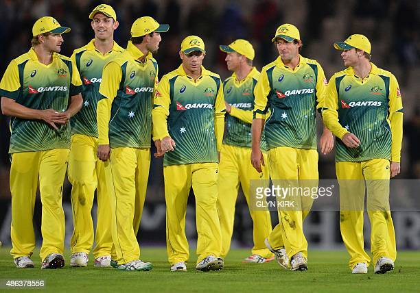 Australia's captain Steven Smith leads his players back to the pavilion after winning the first one day international cricket match between England...