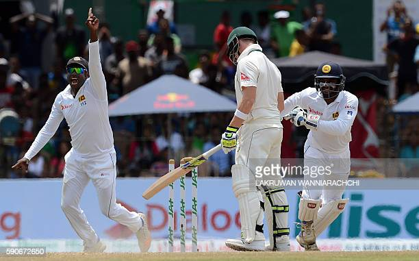 Australia's captain Steven Smith reacts after his dismissal as Sri Lanka's captain Angelo Mathews and wicketkeeper Kusal Perera celebrate during the...