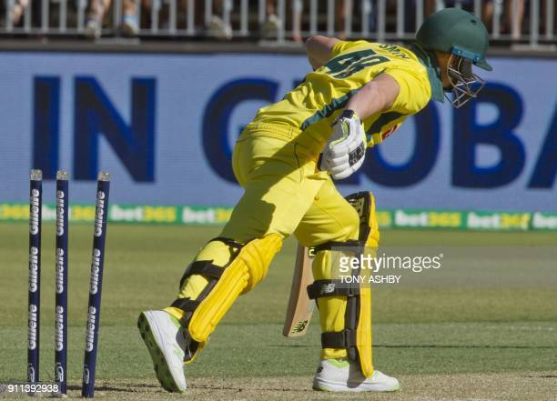 Australia's captain Steven Smith reacts after his dismissal by England's wicketkeeper Jos Buttlerduring the fifth oneday international cricket match...