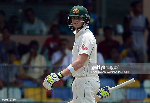 Australia's captain Steven Smith walks back to the pavilion after his dismissal during the final day of the third and final Test cricket match...