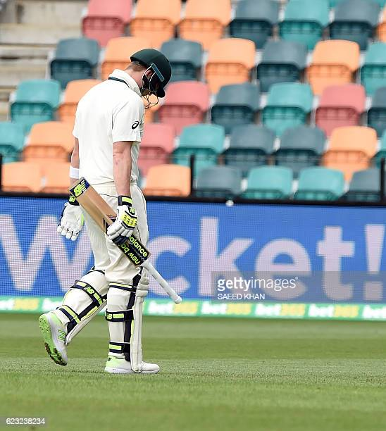 Australia's captain Steven Smith walks off the field with his heads down following his dismissal off South Africa's paceman Kagiso Rabada on the...