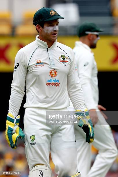 Australia's captain Tim Paine gets back to his fielding position on day two of the fourth cricket Test match between Australia and India at the Gabba...