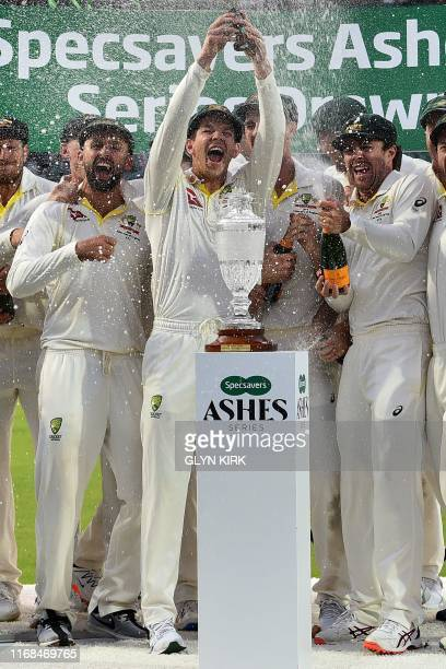 Australia's captain Tim Paine lifts the Ashes Urn aloft during the presentation ceremony on the fourth day of the fifth Ashes cricket Test match...
