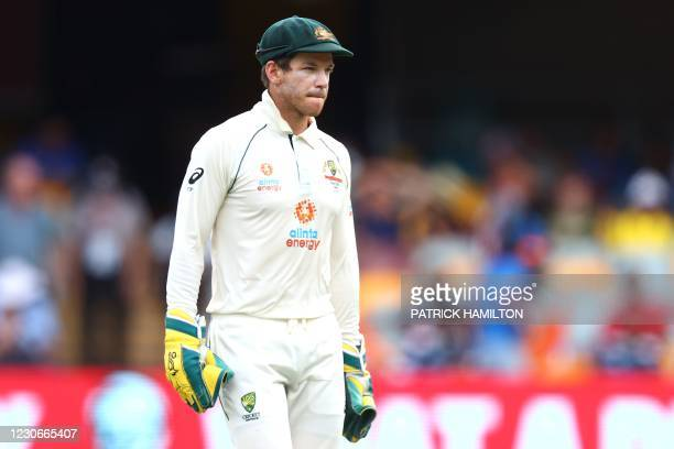 Australia's captain Tim Paine looks on between the overs on day five of the fourth cricket Test match between Australia and India at The Gabba in...
