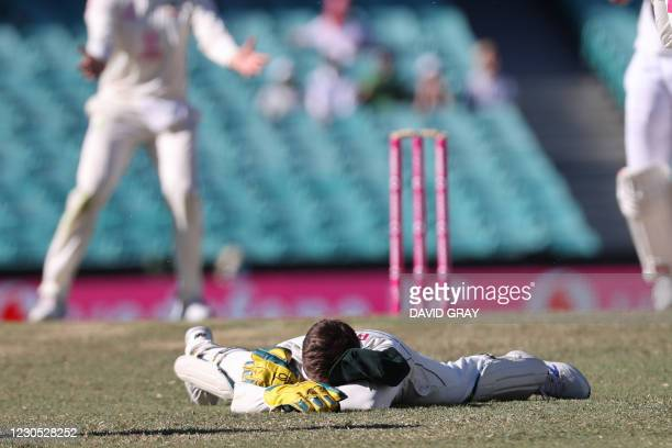 Australia's captain Tim Paine reacts after dropping a catch off India's Hanuma Vihari during the fifth day of the third cricket Test match between...