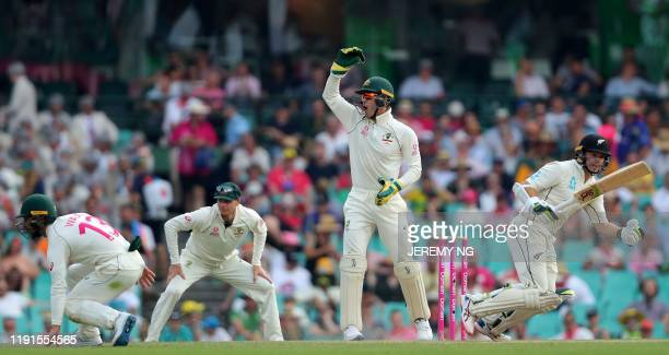 Australia's captain Tim Paine reacts during the second day of the third cricket Test match between Australia and New Zealand at the Sydney Cricket...