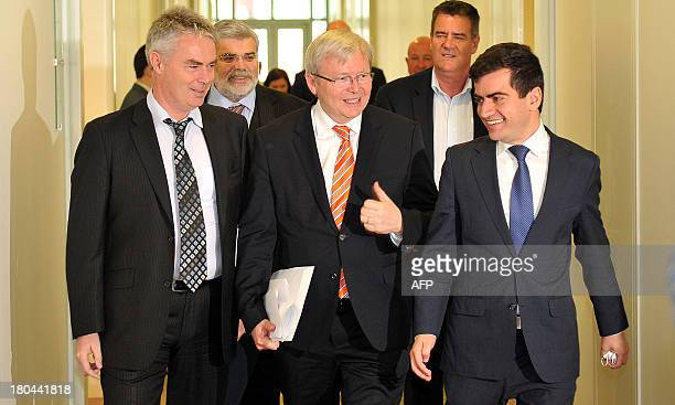 Australia's caretaker Prime Minister Kevin Rudd walks along with Senator Sam Dastyari after Labor party Caucus meeting at the Parliament House in...