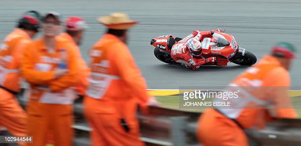 Australia's Casey Stoner of the Ducati Marlboro team steers his bike during the second free practice session of the MotoGP race at the Sachsenring...