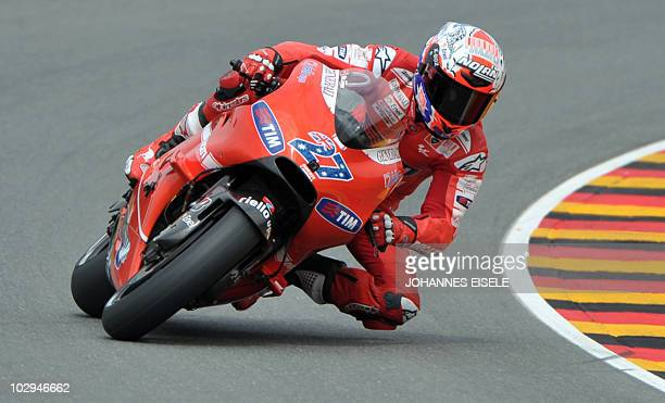 Australia's Casey Stoner of the Ducati Marlboro team steers his bike during the qualifying practice of the MotoGP race at the Sachsenring Circuit on...