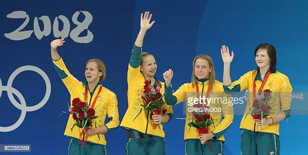 Australia's Cate Campbell Alice Mills Melanie Schlanger and Lisbeth Trickett celebrate with their bronze medal on the podium after the women's 4x100m...