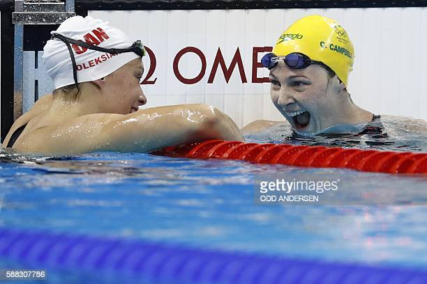 Australia's Cate Campbell and Canada's Penny Oleksiak laugh after competing in the Women's 100m Freestyle Semifinal during the swimming event at the...