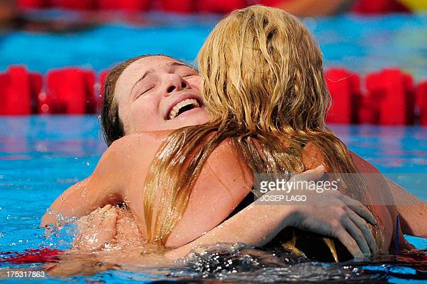 Australia's Cate Campbell hugs Germany's Britta Steffen after winning the final of the women's 100metre freestyle swimming event in the FINA World...