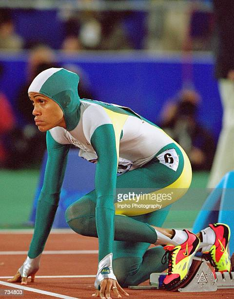 Australia's Cathy Freeman waits in the starting blocks before the Women's 400m Final at the Sydney 2000 Olympic Games September 25 2000 in Sydney...