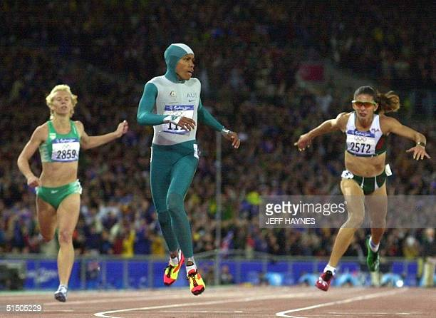 Australia's Cathy Freeman wins the Olympic 400m final followed by South Africa's Heide Seyerling and Mexico's Ana Guevara in Sydney 25 September 2000...