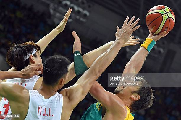 TOPSHOT Australia's centre David Andersen takes a shot over China's centre Wang Zhelin and China's forward Yi Jianlian during a Men's round Group A...