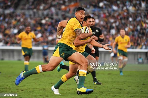 Australia's centre Israel Folau launches to score a try during the Bledisloe Cup rugby union Test match between the New Zealand All Blacks and...