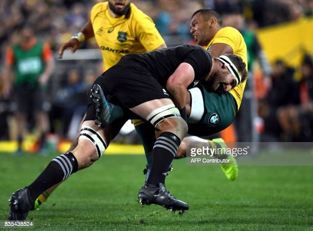 TOPSHOT Australia's centre Kurtley Beale is tackled by New Zealand's No 8 Kieran Read during the Rugby Championship test match between Australia and...