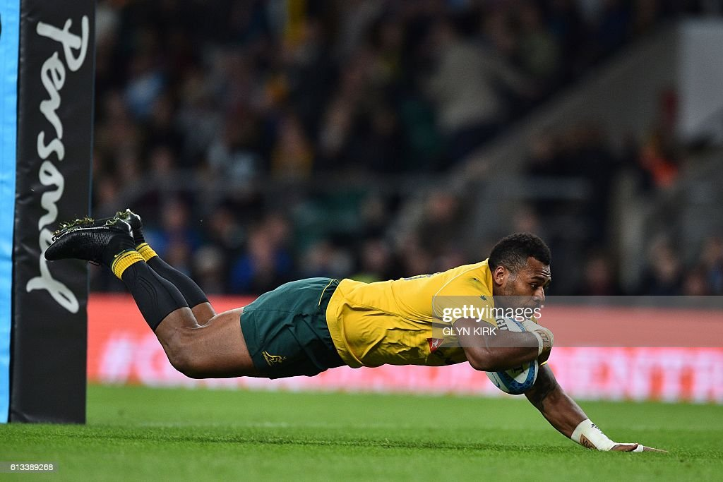 Australia's centre Samu Kerevi dives over the line to score his second try during the Rugby Championship International test match between Argentina and Australia at Twickenham stadium in south west London on October 8, 2016. / AFP / Glyn KIRK