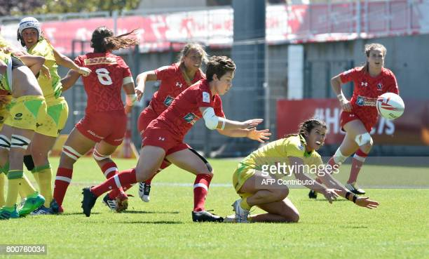 Australia's Charlotte Caslick passes the ball during the Women's rugby 7 World series semifinal match Canada versus Australia on June 25 2017 at the...