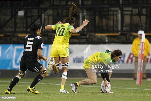 Australia's Charlotte Cassock scores as she is followed by teammate Alicia Quirk and New Zealand's Sarah Goss at the final of the Women's 2016 USA...