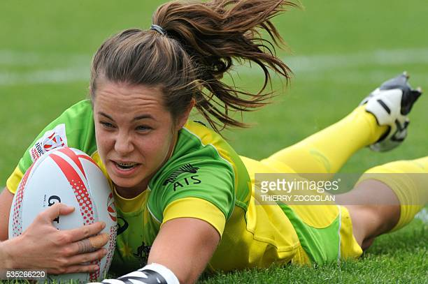 Australia's Chloe Dalton scores a try during the HSBC World Rugby Women's Sevens Series match between Australia and Spain on May 29 2016 at the...