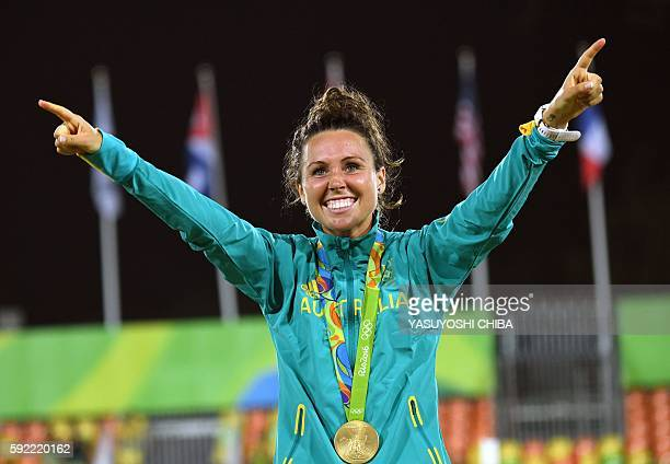 Australia's Chloe Esposito celebrates with her gold medal in the women's modern pentathlon at the Deodoro Stadium during the Rio 2016 Olympic Games...