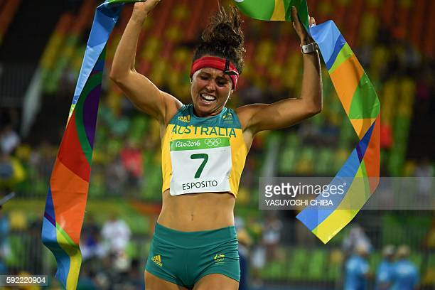 Australia's Chloe Esposito crosses the line to win the combined running/shooting portion of the women's modern pentathlon event at the Deodoro...