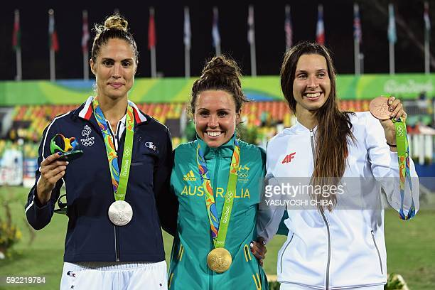 Australia's Chloe Esposito poses with her gold medal next to France's Elodie Clouvel with the silver medal and Poland's Oktawia Nowacka with the...