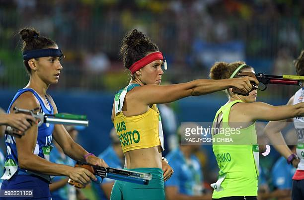Australia's Chloe Esposito shoots in the combined running/shooting portion of the women's modern pentathlon event at the Deodoro Stadium during the...