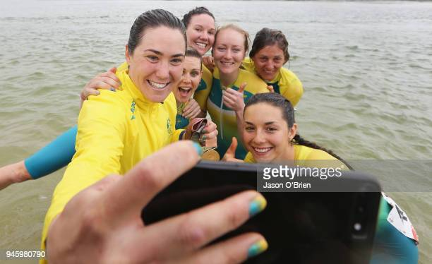 Australia's Chloe Hosking celebrates winning Gold with team mates during the Road Race on day 10 of the Gold Coast 2018 Commonwealth Games at...