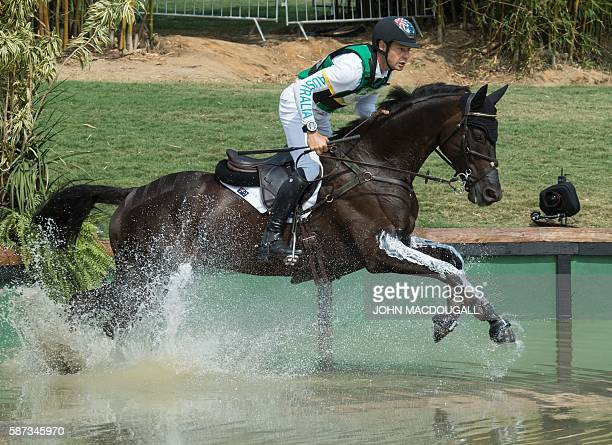 Australia's Chris Burton competes in the Eventing's Cross Country phase of the Equestrian during the Rio 2016 Olympic Games at the Olympic Equestrian...