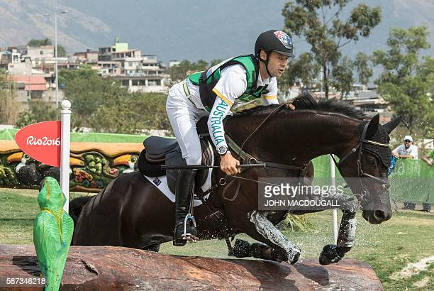 Australia's Chris Burton competes in the Eventing's Cross Country phase of the Equestrian competition during the Rio 2016 Olympic Games at the...