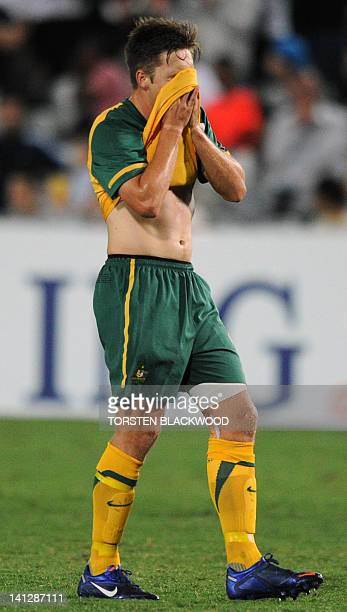 Australia's Chris Harold reacts after missing a shot at the Iraq goal in Gosford on March 14, 2012 during the AFC Asian qualifier for the 2012 London...