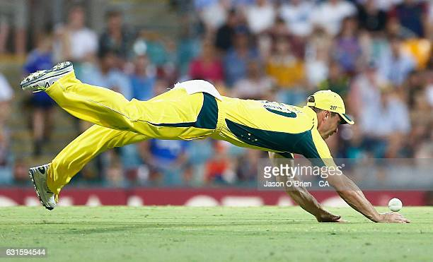 Australia's Chris Lynn dives to stop a ball in the field during game one of the One Day International series between Australia and Pakistan at The...