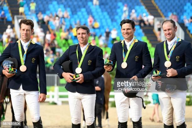 Australia's Christopher Burton, Australia's Sam Griffiths, Australia's Shane Rose and Australia's Stuart Tinney celebrates on the podium of the...