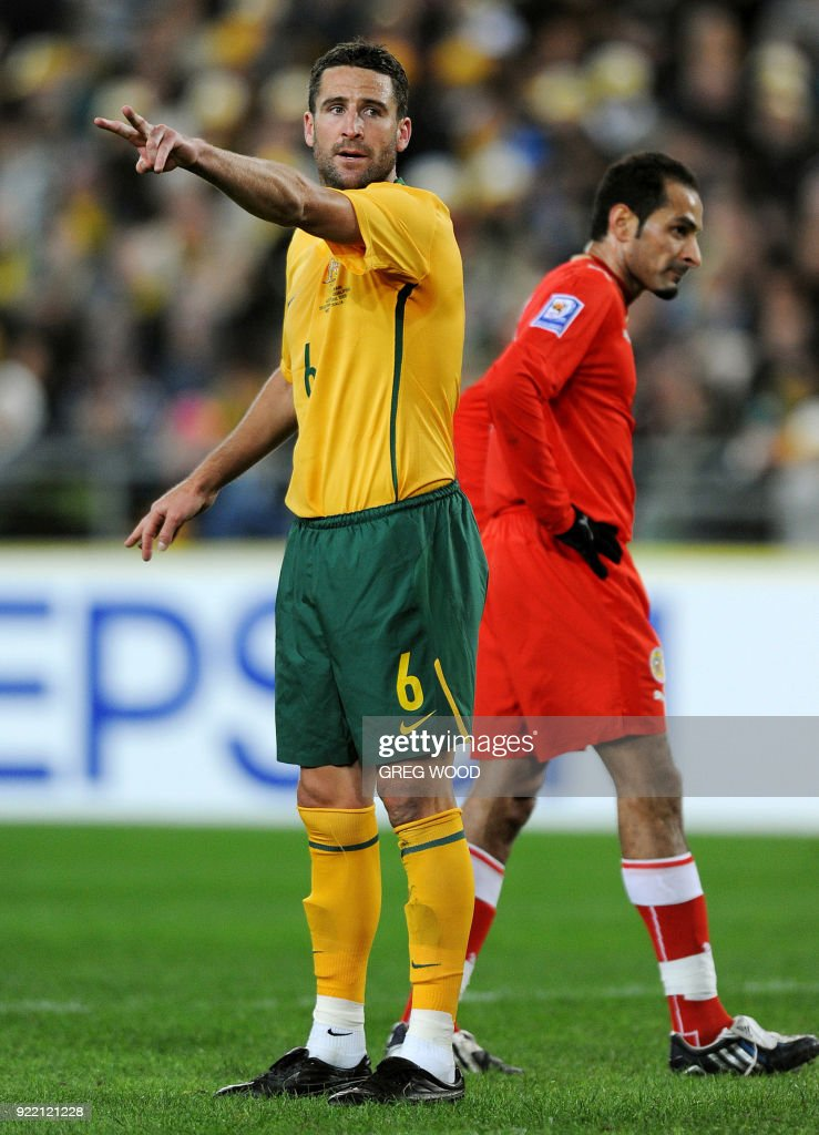 Australia's Christopher Coyne gestures to a team mate during their World Cup Asia Zone qualifier football match against Bahrain in Sydney on June 10, 2009. The Socceroos won 2-0. AFP PHOTO / GREG WOOD / AFP PHOTO / Greg Wood
