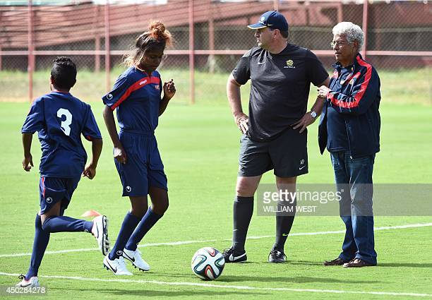 Australia's coach Ange Costecoglou and Jim Moriarty watch a group of young Aboriginal soccer players from Australia's Northern Territory train during...