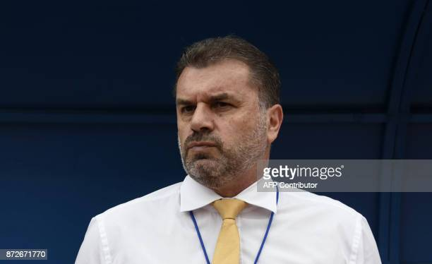 Australia's coach Ange Postecoglou is pictured before the start of the first leg football match of their 2018 World Cup qualifying playoff against...