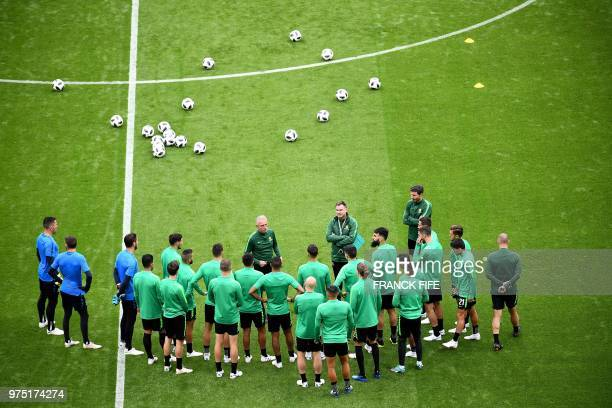 TOPSHOT Australia's coach Bert van Marwijk speaks to his players as he leads a training session of Australia national football team at the Kazan...
