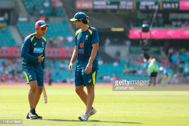 Australia's coach Justin Langer and batsman Joe Burns talk prior to the second day of the third cricket Test match between Australia and New Zealand...