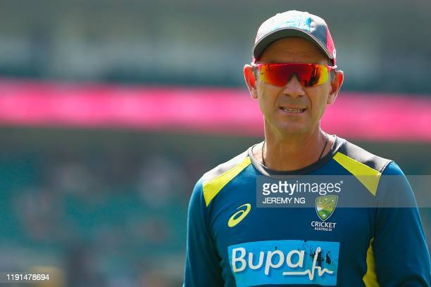 Australia's coach Justin Langer looks on during the second day of the third cricket Test match between Australia and New Zealand at the Sydney...