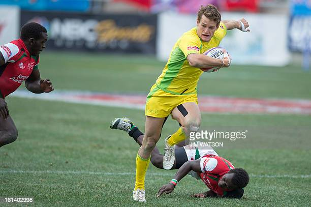 Australia's Con Foley vies with Kenya defenders during Day 3 of the USA Sevens Las Vegas HSBC Sevens World Series Round 5 at Sam Boyd Stadium in Las...