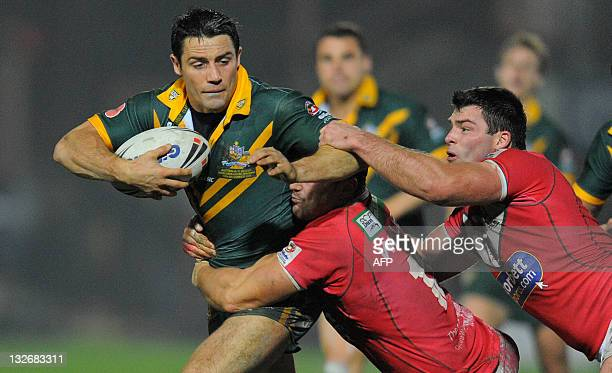 Australia's Cooper Cronk holds off the Welsh defense on November 13 2011 during a Four Nations rugby league test match between Wales and Australia at...