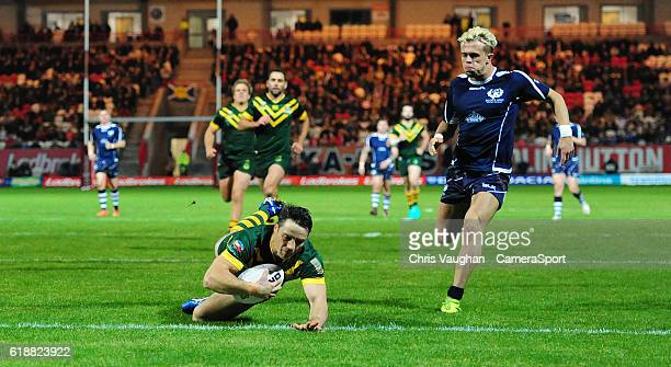 Australia's Cooper Cronk scores his sides fourth try during the Four Nations match between the Australian Kangaroos and Scotland at Lightstream...