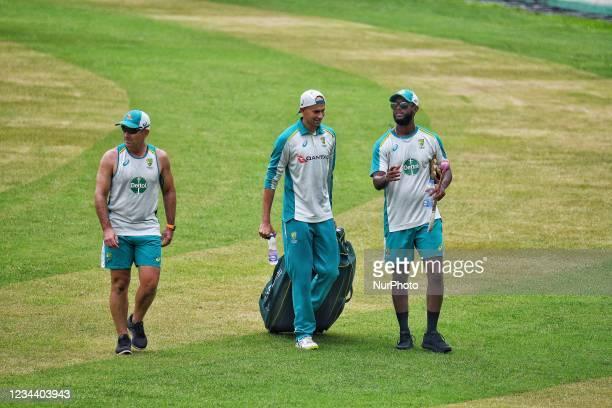 Australia's Cricket Coach Justin Langer and Ashton Agar during practice session at Sher e Bangla National Cricket Stadium in Dhaka, Bangladesh on...